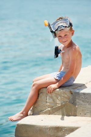 boy swim: smiling boy with snorkeling gear