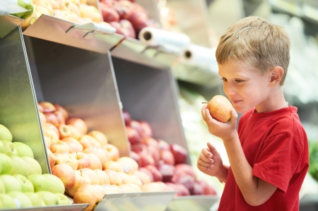 grocery stores: child boy choosing fruits vegetable shopping