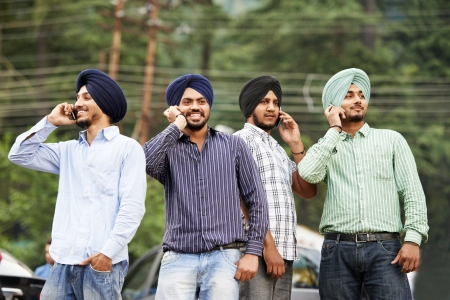 sikh: Young indian sikh men with mobile phones