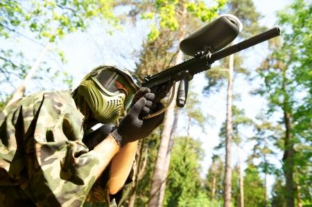 gunfire: paintball player holding fire