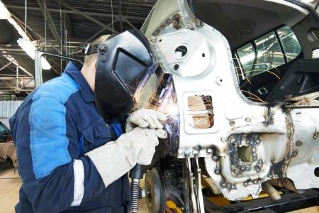 bodywork: repairman welding metal body car Stock Photo