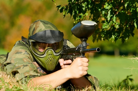 paintball: paintball player holding fire