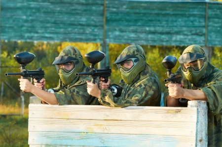 paintball: paintball players team aiming markers Stock Photo
