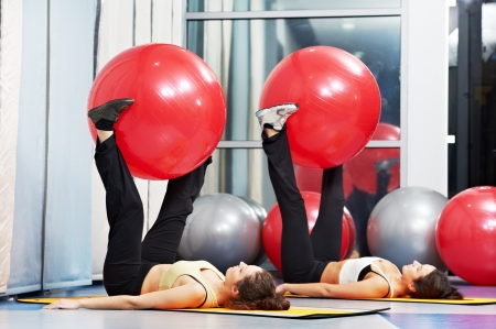 strength training: women at exercise with fitness ball
