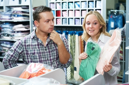 Young couple at clothes shopping Stock Photo - 18787638