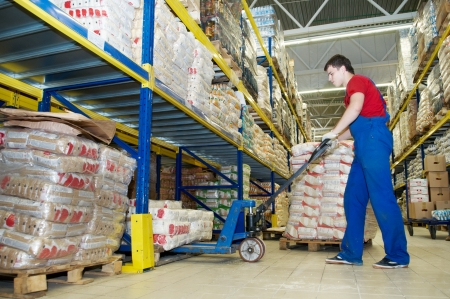 food distribution: warehouse worker with forklift stacker