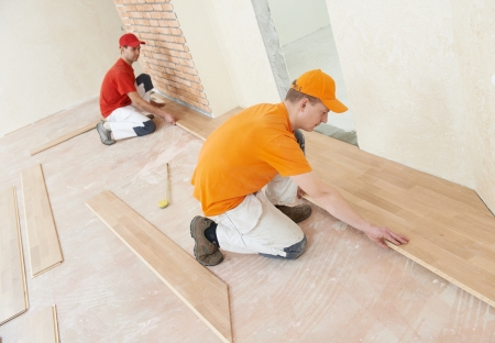 restoration: parquet workers at flooring work