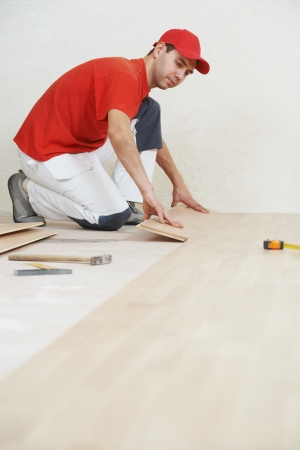 tongue and groove: carpenter worker joining parket floor