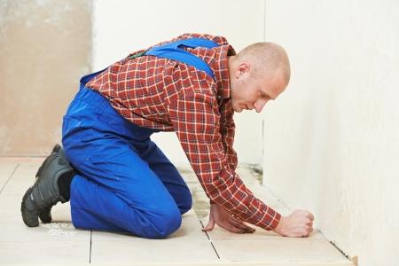 tiler at home floor tiling renovation work photo