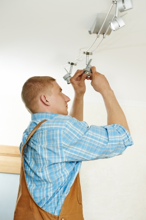 ceiling lamps: Electrician at wiring work