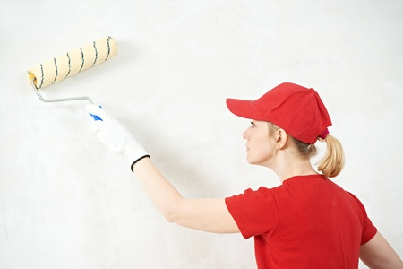 woman painter at indoor work photo