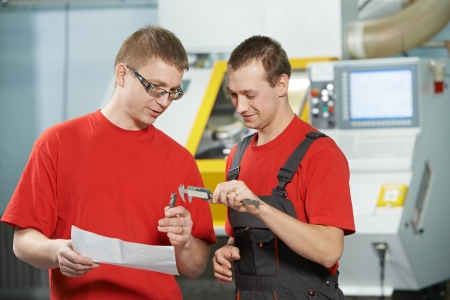 tool and die: industrial workers at tool workshop Stock Photo