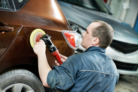 wax: auto mechanic polishing car