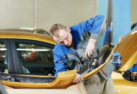 car body: repairman grinding metal body car
