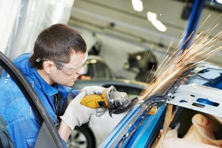 grinding: repairman grinding metal body car