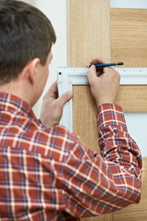deadbolt: carpenter at door installation