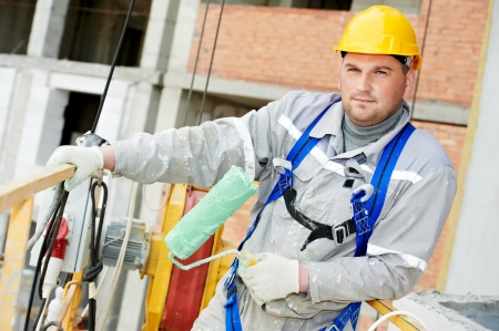 master: Portrait of builder facade painter at work Stock Photo