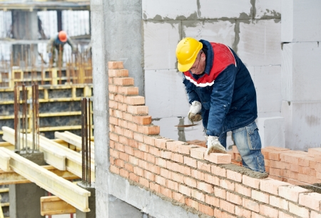laborers: construction mason worker bricklayer Stock Photo