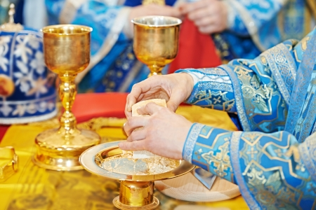 Orthodox Christian euharist sacrament ceremony photo