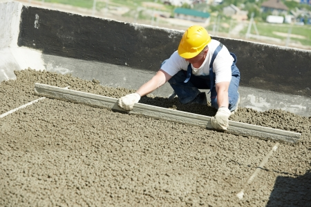 leveling: worker roofer with float lute Stock Photo