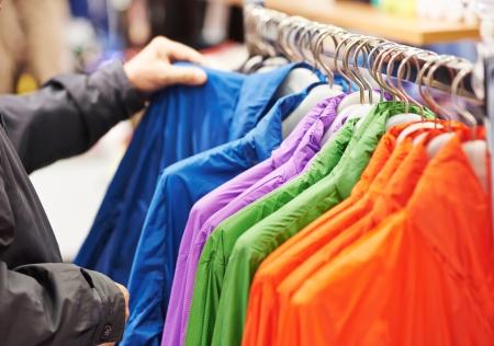 choosing clothes: Close-up hands choosing clothing Stock Photo