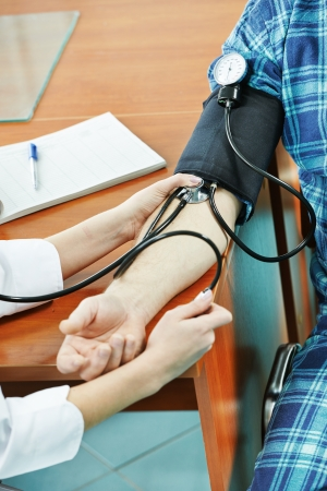 healthcare worker: Blood pressure medic test Stock Photo