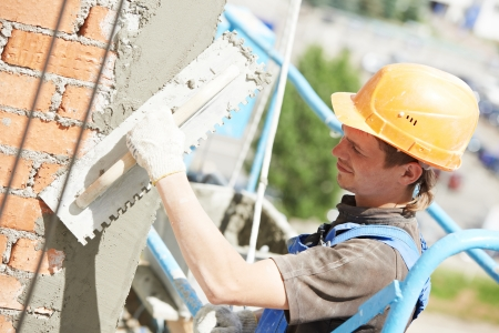tether: facade builder plasterer at work Stock Photo