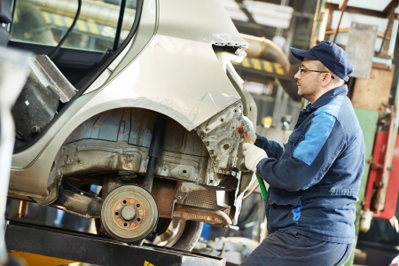 peen: auto repair man flatten metal body car Stock Photo