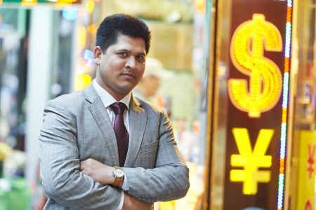 Smiling young indian businessman photo