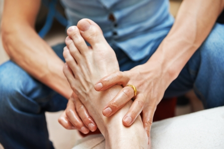 preassure: Foot massage Stock Photo