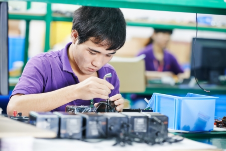 factory line: chinese male worker at manufacturing