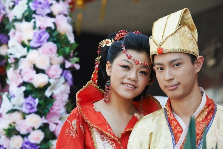 chinese flower: happy chinese young couple Stock Photo