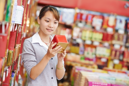 asian produce: chinese woman shopping food Stock Photo