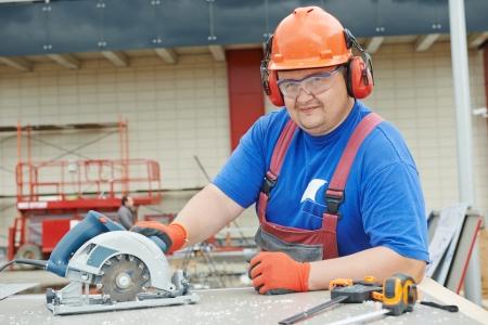 jobsite: Portrait of builder worker at construction site