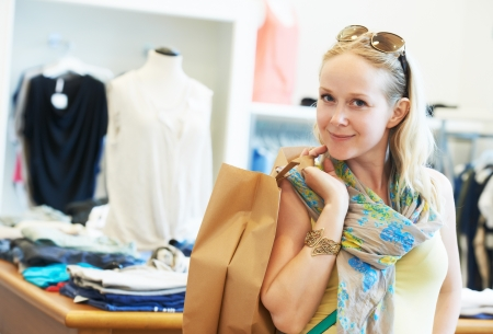 Young woman at apparel clothes shopping photo