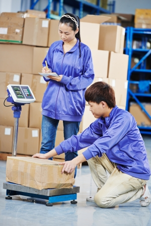 two chinese workers in warehouse Stock Photo - 21027595
