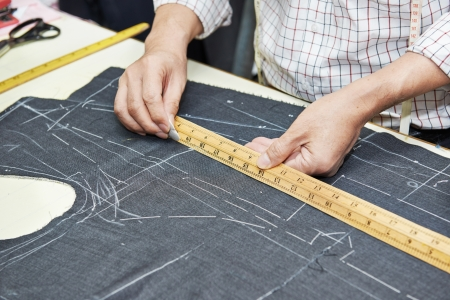 tailor measure: Tailor hands at works