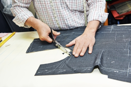 tailor suit: Tailor hands at works