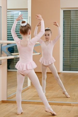 petite girl: Little girl at ballet training