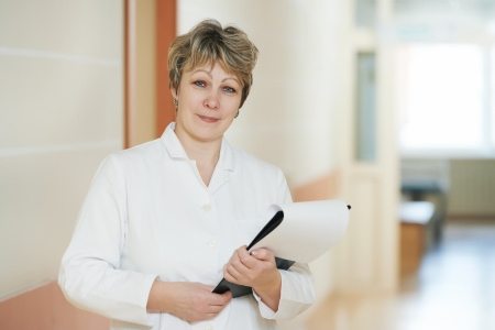 Adult female doctor in hospital clinic hall photo