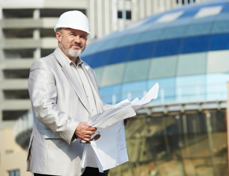 geodesist: One adult construction site manager boss worker at building area
