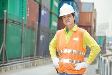 Portrait of adult chinese terminal cargo dock warehouse worker in front of container photo