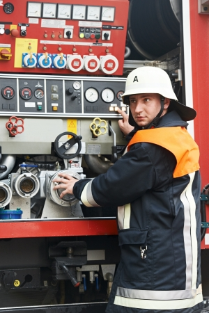 forcing: Fireman in uniform operating fire engine or fire truck on duty during training