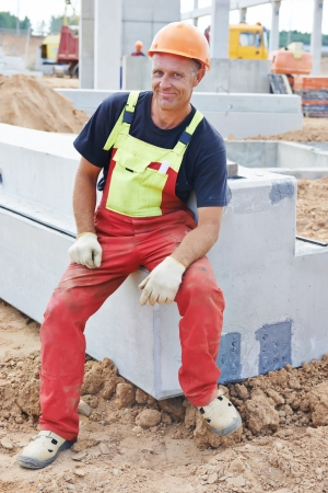 One adult smiling happy construction worker at building area photo