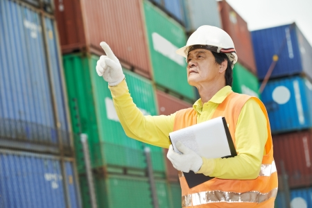 adult chinese terminal cargo dock warehouse worker in front of container photo