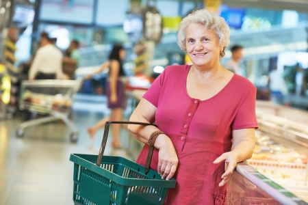 woman during shopping at fruit vegetable supermarket photo