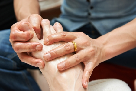 preassure: Masseur making a traditional chinese foot massage to adult leg and foot