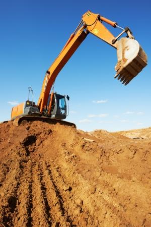 loader excavator machine doing earthmoving work at sand quarry photo