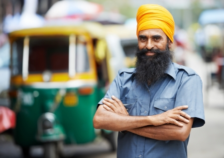 Indian auto rickshaw three-weeler tuk-tuk taxi driver man photo