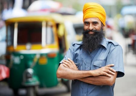 trishaw: Indian auto rickshaw three-weeler tuk-tuk taxi driver man